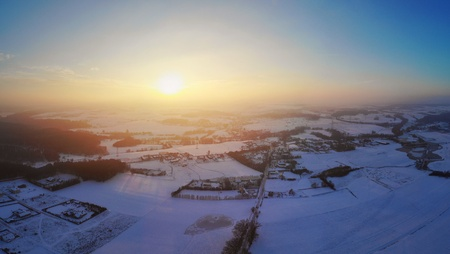 Top view aerial shot of foggy Polish village