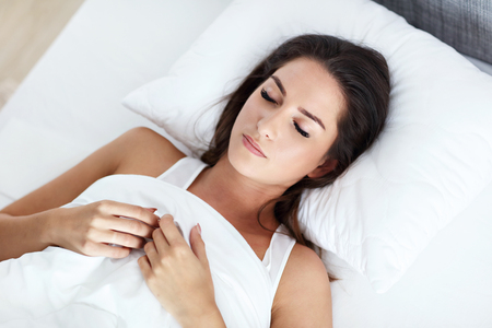 Young beautiful woman sleeping in bed Stock Photo