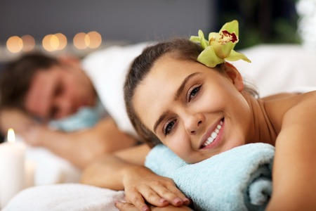 Adult happy couple relaxing in spa salon
