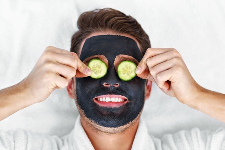 Picture of handsome man having facial in spa salon Zdjęcie Seryjne