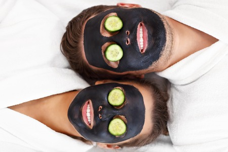 Picture of happy couple having facial in spa salon