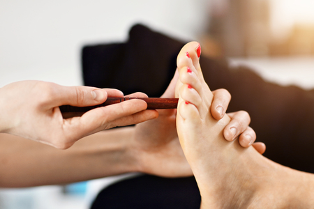 Woman receiving a thai foot massage at the health spa