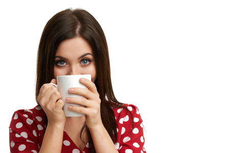 Caucasian brunette woman with mug of coffee isolated over white background