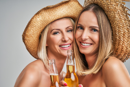 Girls partying in hats and toasting drinks