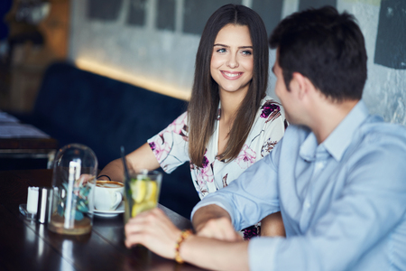 Romantic couple dating in restaurant