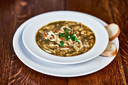 Polish beef tripe soup served on wooden table 版權商用圖片
