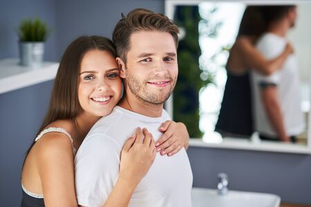 Happy young couple cuddling in the bathroom Stockfoto