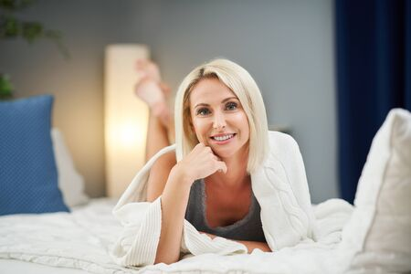 Adult beautiful woman waking up fully rested.