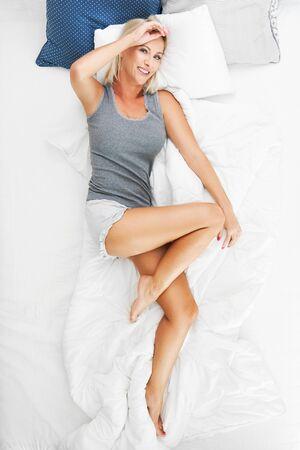 Adult beautiful woman waking up fully rested. Фото со стока - 130840924