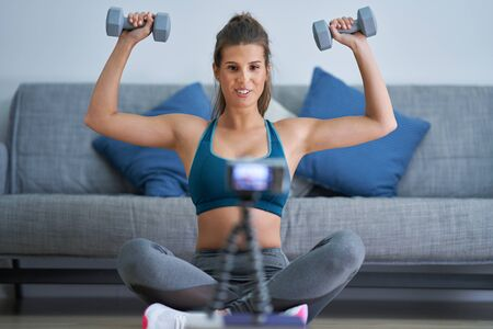 Fitness vlogger influencer recording live tutorial video