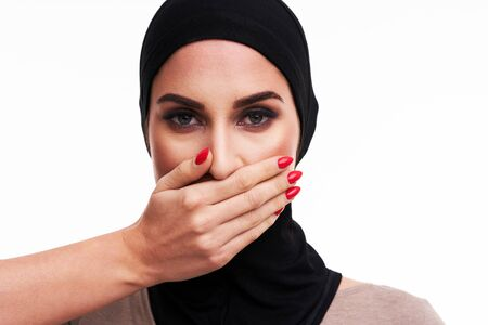 Muslim woman over white background Banco de Imagens