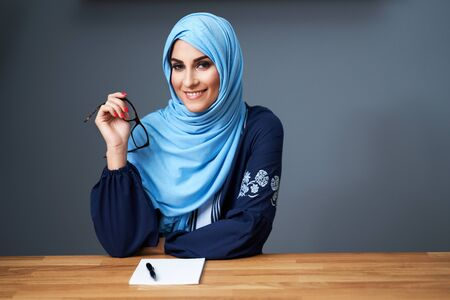 Muslim female student learning at home Banco de Imagens