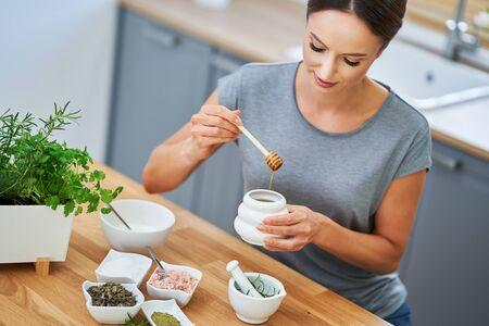 Beautiful healthy woman preparing natural cosmetics at home Zdjęcie Seryjne