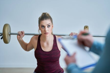 Woman with her personal fitness trainer