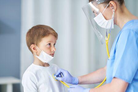Portrait of adorable little boy having doctors appointment