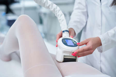 Adult woman in beauty salon undergoing anti cellulite and slimming treatment Zdjęcie Seryjne