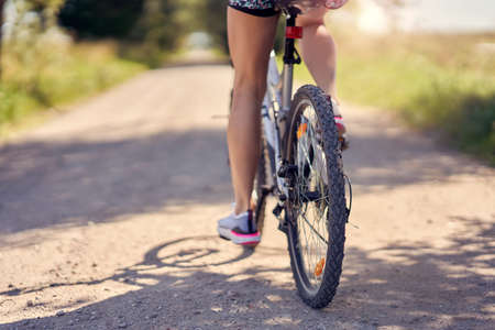 Midsection of a woman on bike