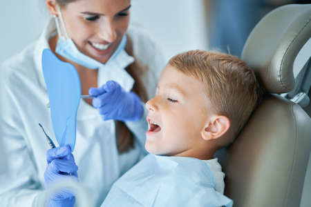 Little boy and female dentist in the dentists office Stock Photo