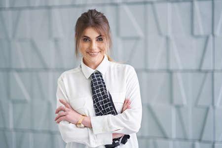 Businesswoman posing over modern background Banco de Imagens