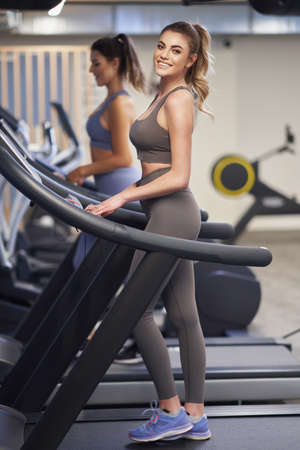 Two girl friends working out on treadmill Stock fotó