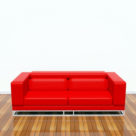 Red sofa on the floor behind a white wall photo