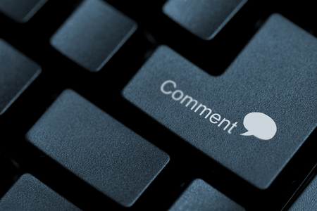written: Close up of black buttons on a keyboard with the word comment and a speech bubble written on one of them Stock Photo