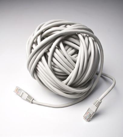 cat5: Rolled computer cables on grey background indicating a network problem