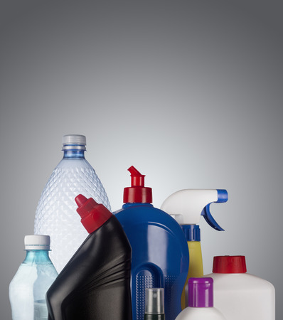 reprocess: Set of plastic containers isolated on grey background, ready for recycle
