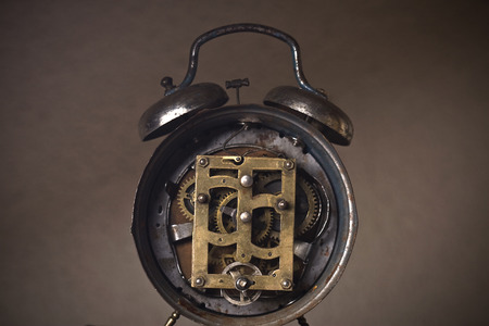 revealed: Back of an old rusted clock with its mechanism and cogs revealed