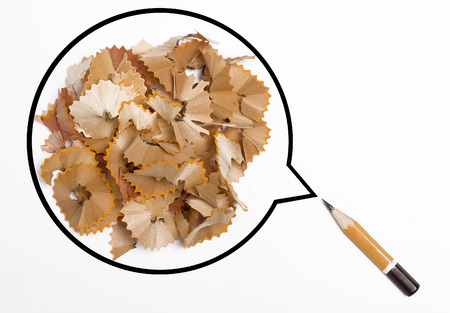 shards: Small orange pen with a speech bubble filled with wood shards isolated on white background