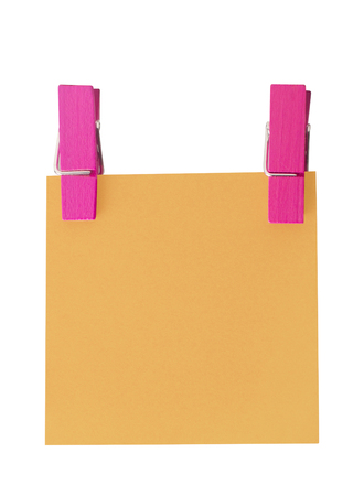 held: Orange paper note held by two pegs on white background Stock Photo