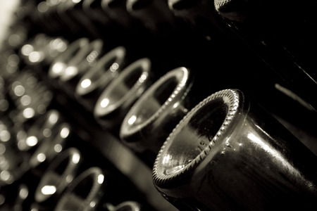 fermenting: Horizontal perspective view of rows of many champagne bottles in a wine cellar