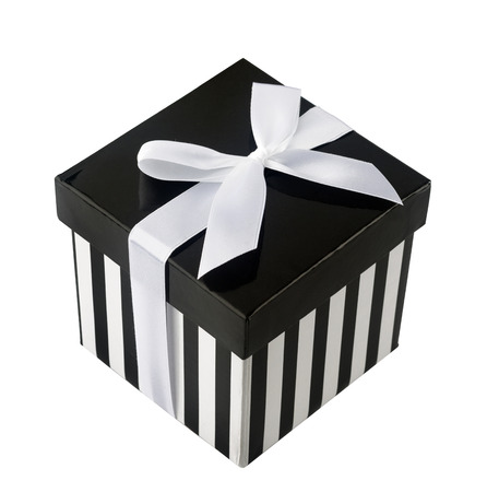 closed ribbon: Closed box with black and white stripes and white ribbon isolated on white background Stock Photo