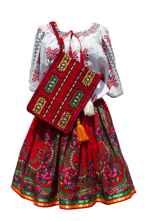 garments: Front view of a Romanian traditional dress with garments and purse isolated on white Stock Photo