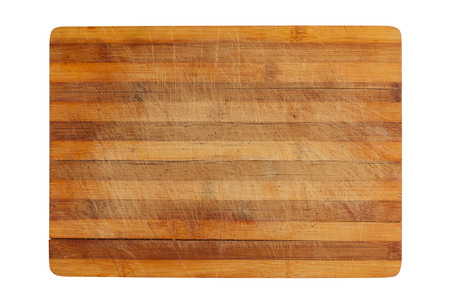 heavily: top view of a heavily used wood kitchen cutting board isolated on white background
