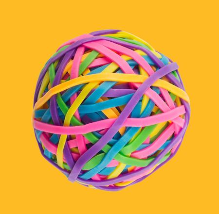distinct: Rubber elastic band ball on light yellow background Stock Photo