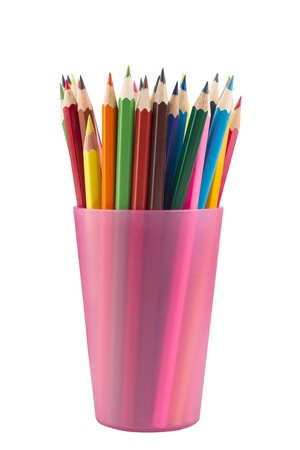 Many drawing pencils in a pink transparent cup isolated on white Stock Photo