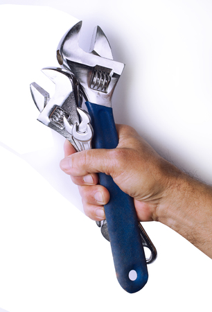 Front view of strong man hand holding tightly a set of working tools isolated on white background Stock Photo