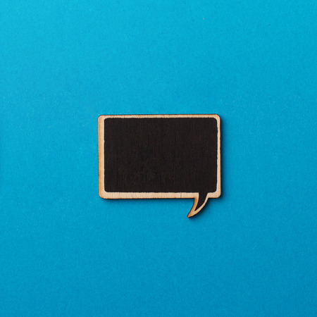 communication metaphor: Top view of square chalk board speech bubbles on blue background, metaphor concept for communication