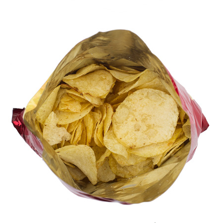 corn chip: top view of red open round potato snacks open bag packaging isolated on white background