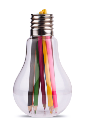 front view of a large light bulb holding many colored pencils inside. concept for ideas, creativity, teamwork Stock Photo