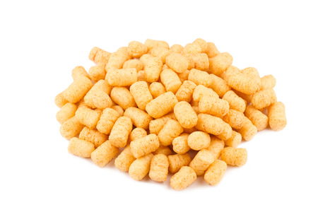side view of many corn puff snacks isolated on white background Stock Photo