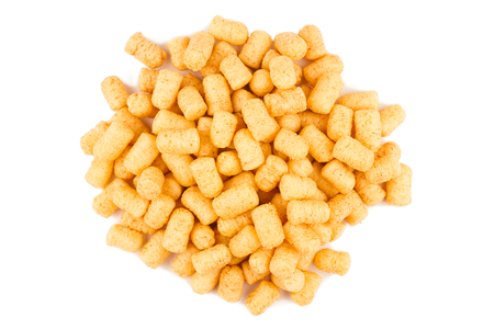 top view of many corn puff snacks isolated on white background