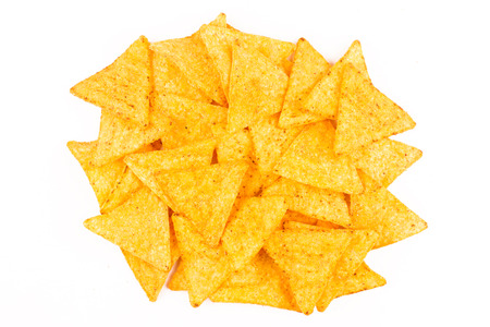 top view of nachos chips on top of each other isolated on white background