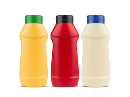 ケチャップ マヨネーズとマスタード空ペットボトルの白い背景に分離筐体のフロント ビュー 写真素材