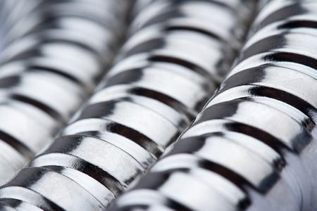 waterspout: macro closeup of metallic corrugated tube texture
