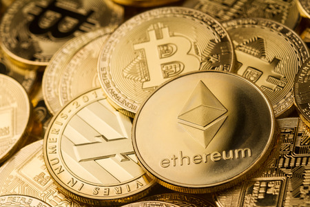 horizontal top view closeup of ethereum litecoin and bitcoin stack of golden coins background texture exchange concept Stock Photo