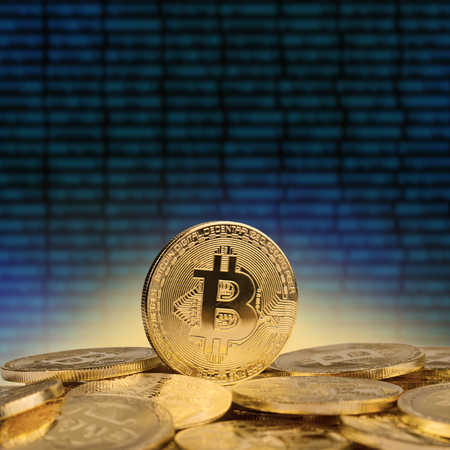 concept 3d illustration with one cryptocurrency golden coins standing on a pile of bitcoins with abstract blue pattern background front view Stock Photo