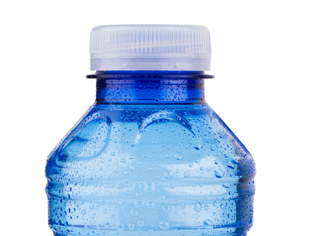 front view closeup of small blue plastic pet bottle with vitamin water white cap and cool condensation droplets isolated on white background
