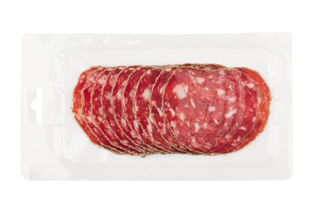 top view of smoked salami chorizo sausages slices in transparent vacuum plastic packaging isolated on white background